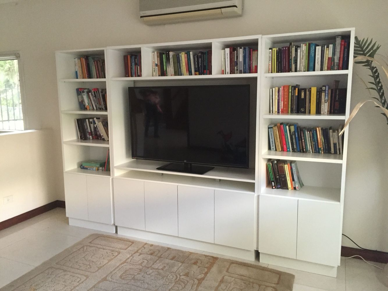 Biblioteca y mueble para tv mubles bookcase home for Muebles bibliotecas para living