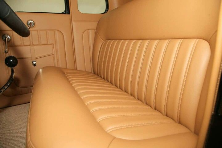 Tan Leather Interior With Door Pouches And Sweet Swooping