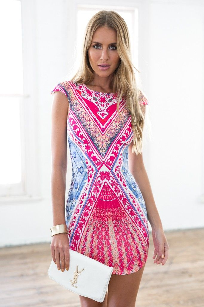 A sheer mesh knit dress by Kikiriki™ featuring allover