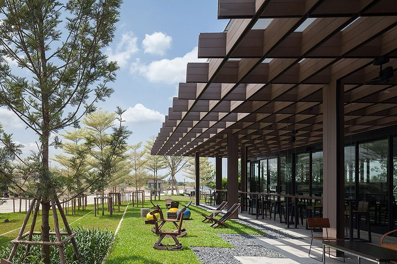 integrated field tops 'it's sara' café with latticed roof canopy Architecture Commercial
