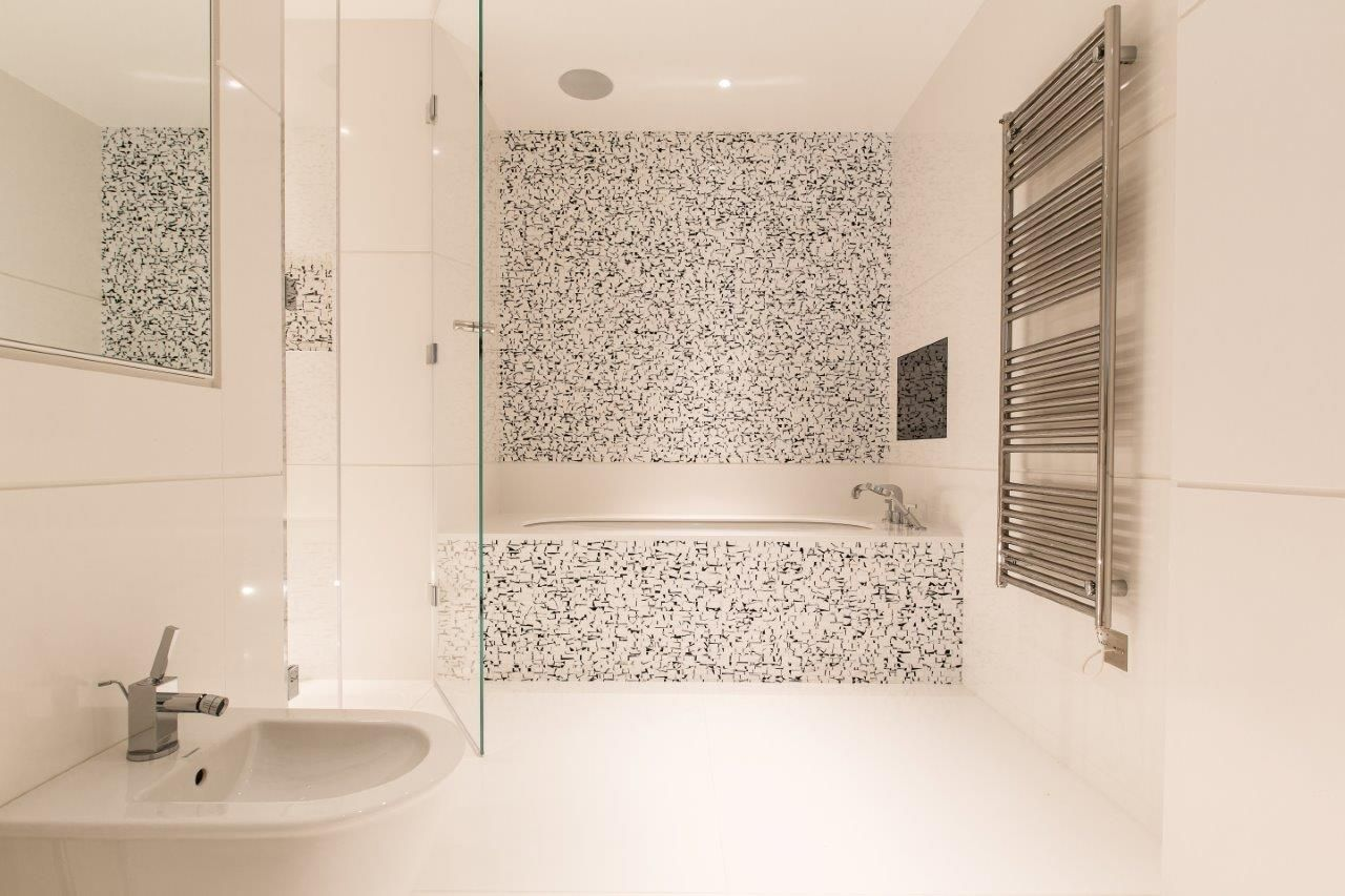 North London Townhouse - Chic family bathroom with feature tiling ...