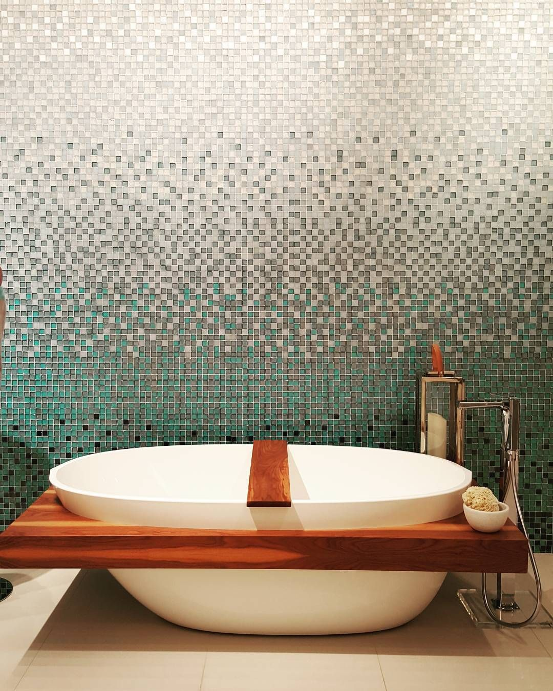 Gorgeous blue ombre tile wall creates a stunning backdrop for the deep soaking tub! Wanted to jump in and never leave but think that would be a bit embarrassing on the @thepirch showroom floor! ;) #dbcatl @designbloggersconference #blog #blogging #bloggers #interiors #interiordesign #interiordesigner #idcdesigners #designhounds #design #home #luxury #FeiaConstruction #bathroom #tub #bath #bathtime #tile #tiledesign #blue #ombre #mosaic #gorgeous #stunning #remodel #reno by susiefeia