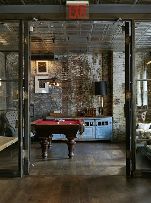 Industrial interior design. I love the wall... And the exit sign is amazing
