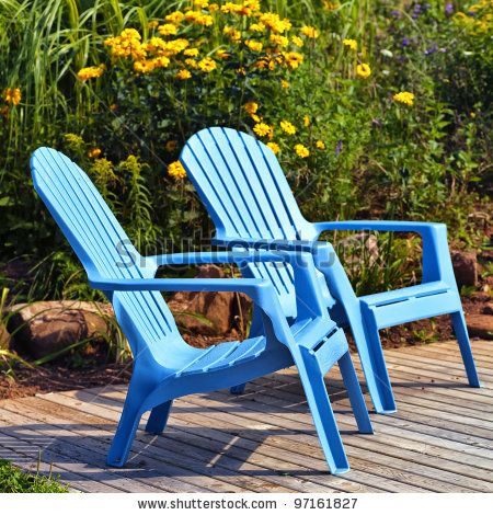 Attractive Brilliant Blue Plastic Outdoor Adirondack Chairs On The Deck In A Summer  Garden. By V. J.