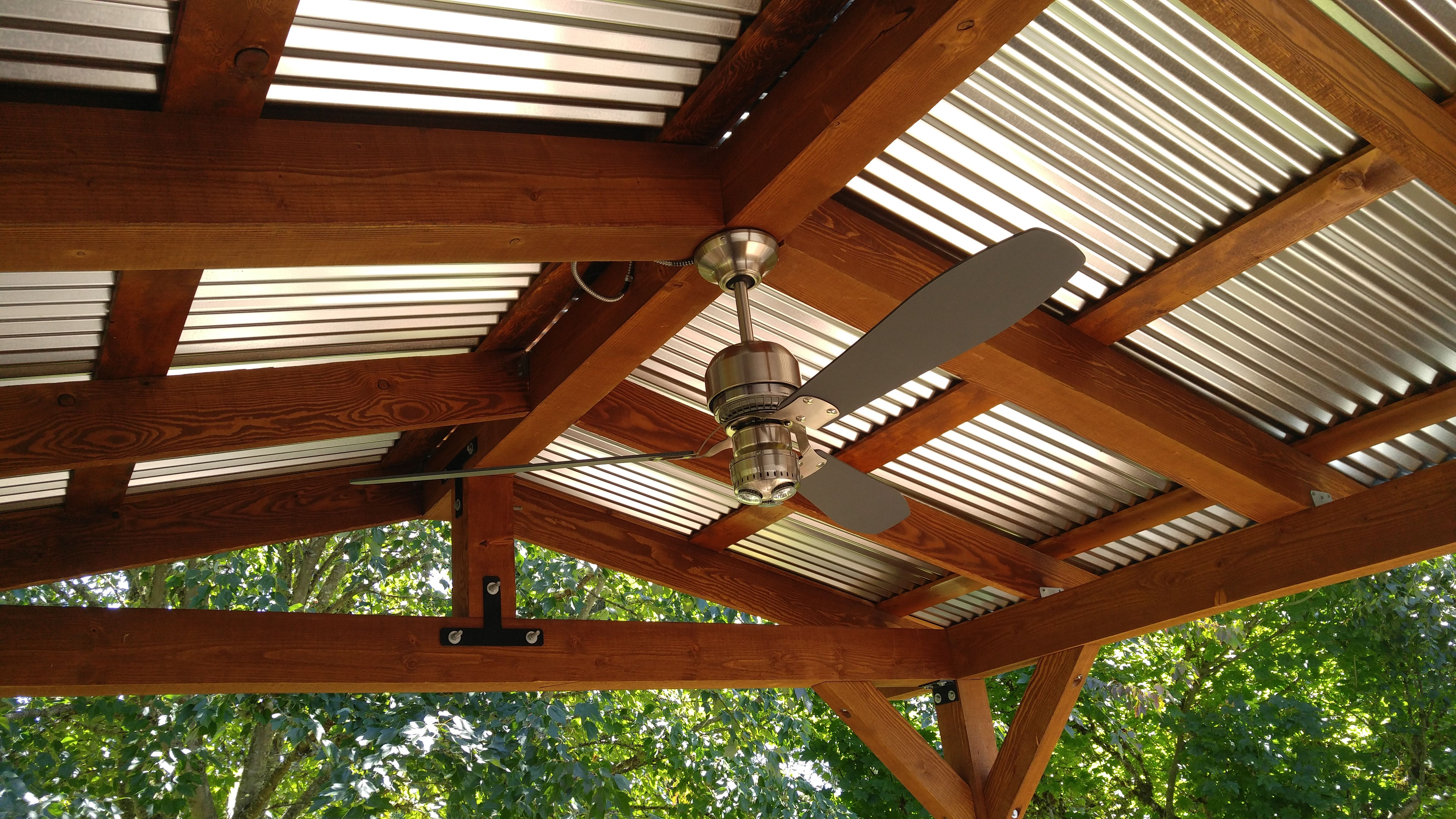 New Patio Cover Corrugated Metal Roof And Industrial Fan Complement The Dark Wood Stain Metal Patio Covers Corrugated Metal Roof Pergola