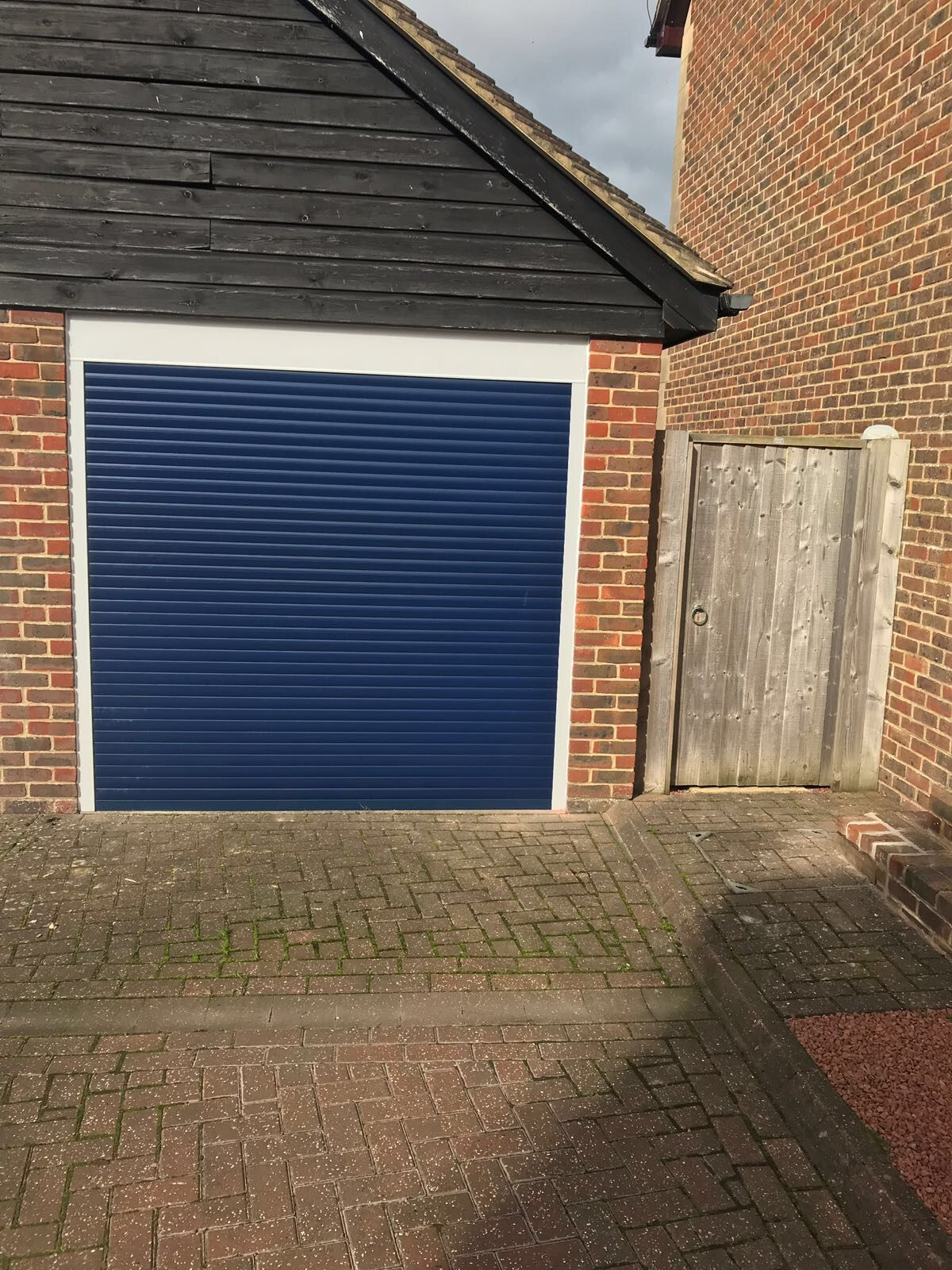 Blue Insulated Roller Shutter Door With White Frame And Top Box