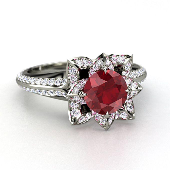 Brides.com: Red Engagement Rings. Gemvara platinum Lotus ring with ruby and diamond, $12,230, Gemvara  See more platinum engagement rings.
