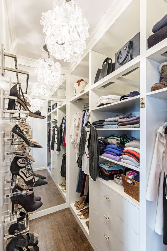 Custom-made shoe shelves and lighting create a secondary master closet, as in this example for a teen's closet in Manhattan.
