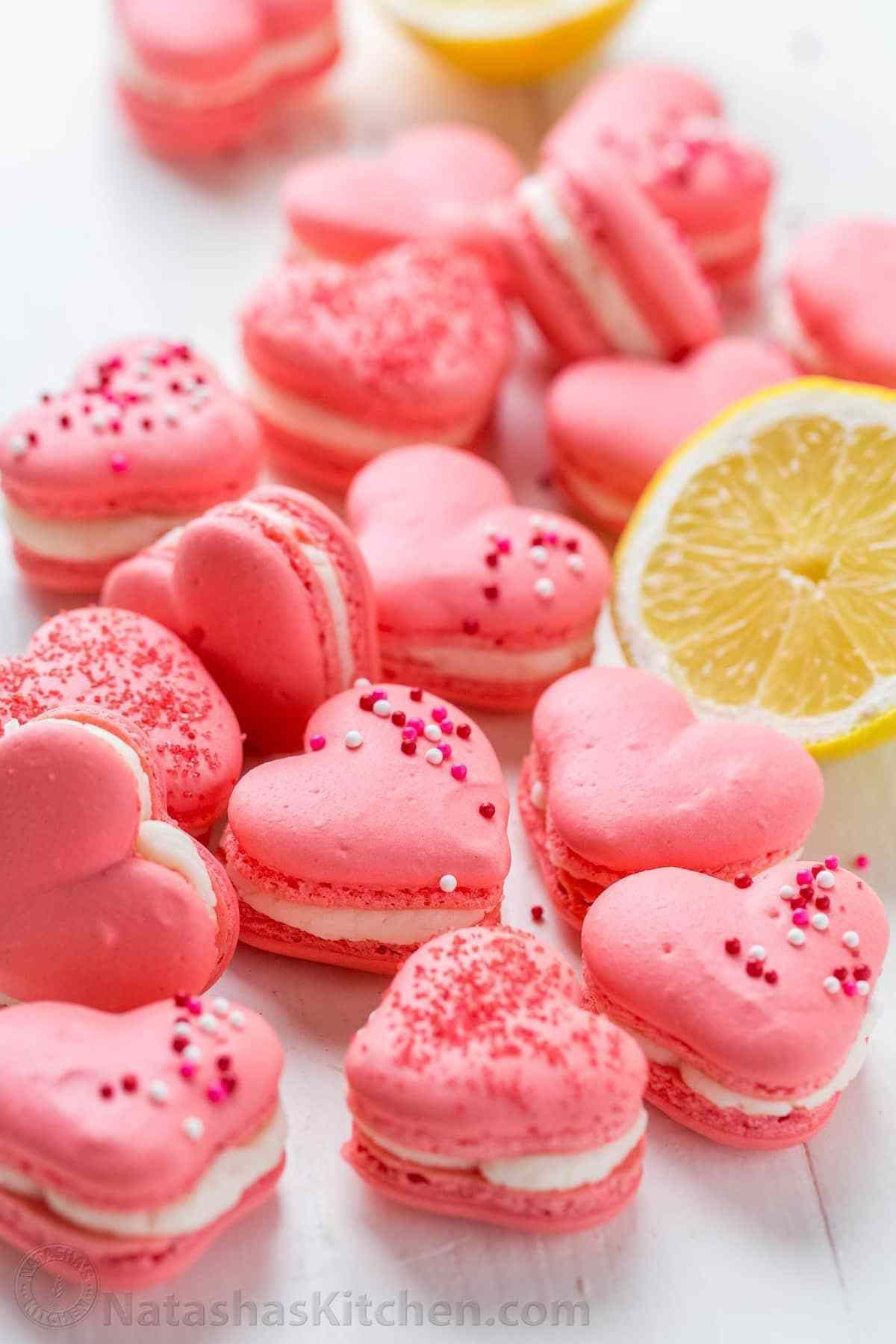 Heart Macarons with Lemon Buttercream (VIDEO) - NatashasKitchen.com #lemonbuttercream Heart Macarons with Lemon Buttercream (VIDEO) - NatashasKitchen.com #lemonbuttercream