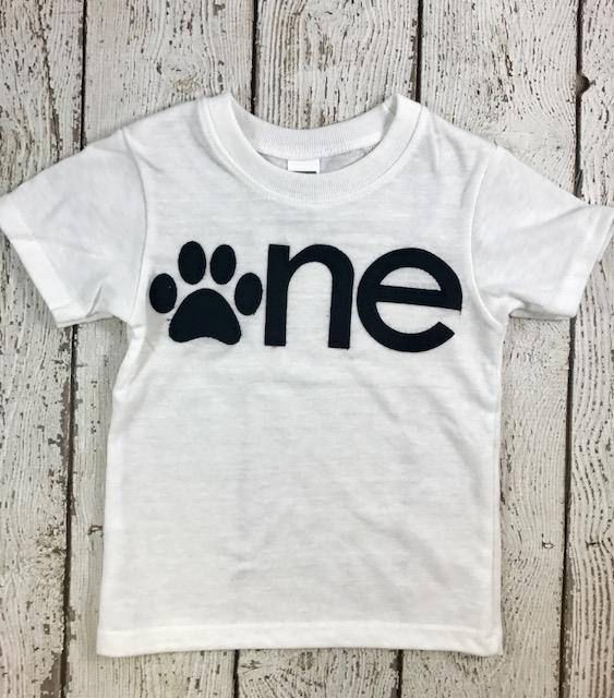 one of a kind and absolutely adorable. Perfect tee to celebrate a birthday, gift or everyday wear. Lettering and cute paw print applique can be created in whatever color(s) you like.  Please see sizing/color chart for available shirt size and color options. ***lil threadz loves custom orders! If you dont see a theme or print that floats your boat in the shop please contact me to arrange a custom order.   PLEASE READ ALL DETAILS REGARDING SHIRT SELECTION, SIZING AND ORDER PROCESSING CAREF...