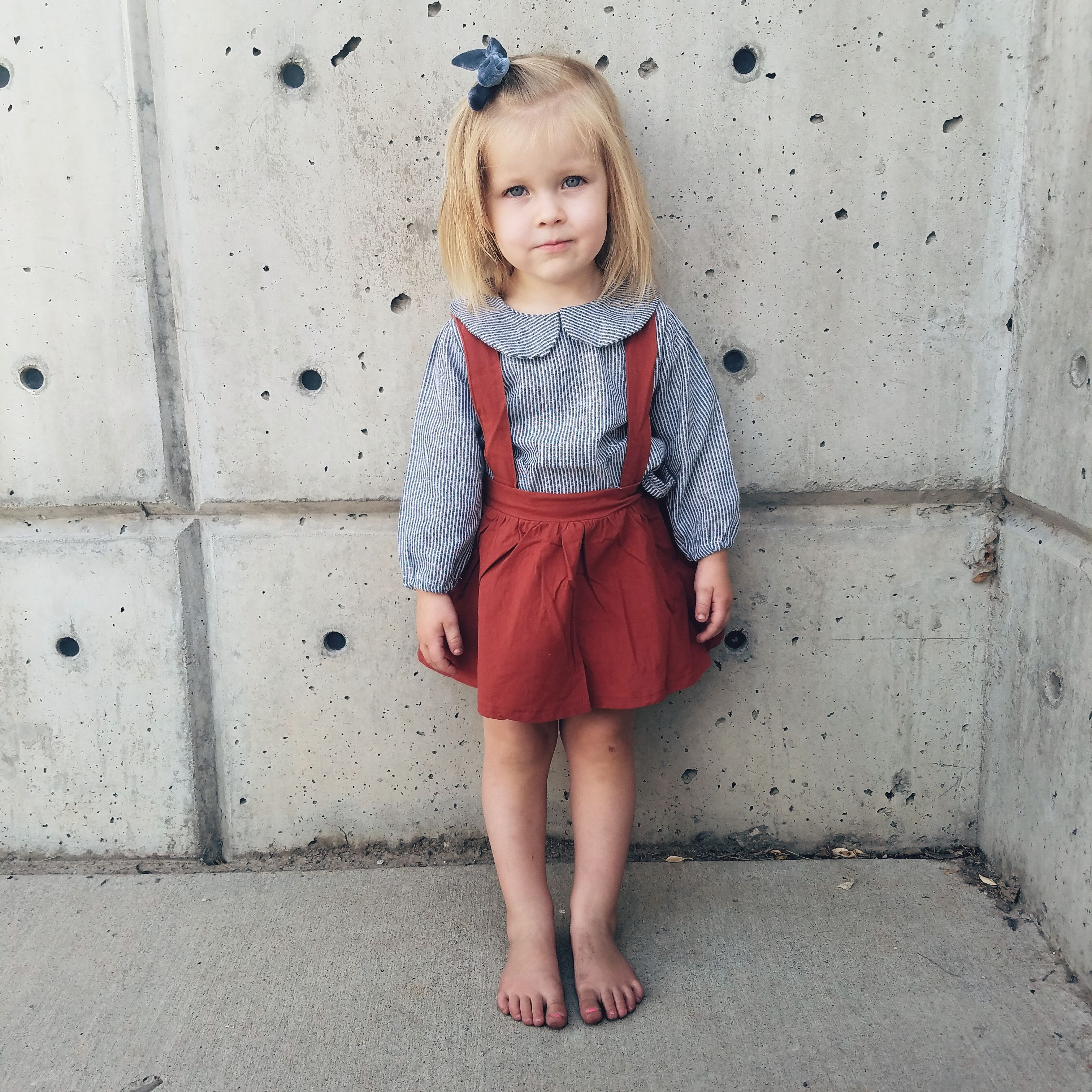 Chambray striped top with collar brown overall skirt both from