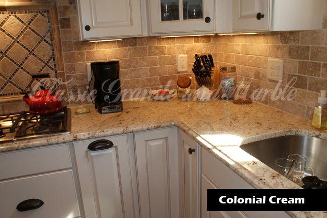 Colonial Cream Granite With Darker Travertine Backsplash