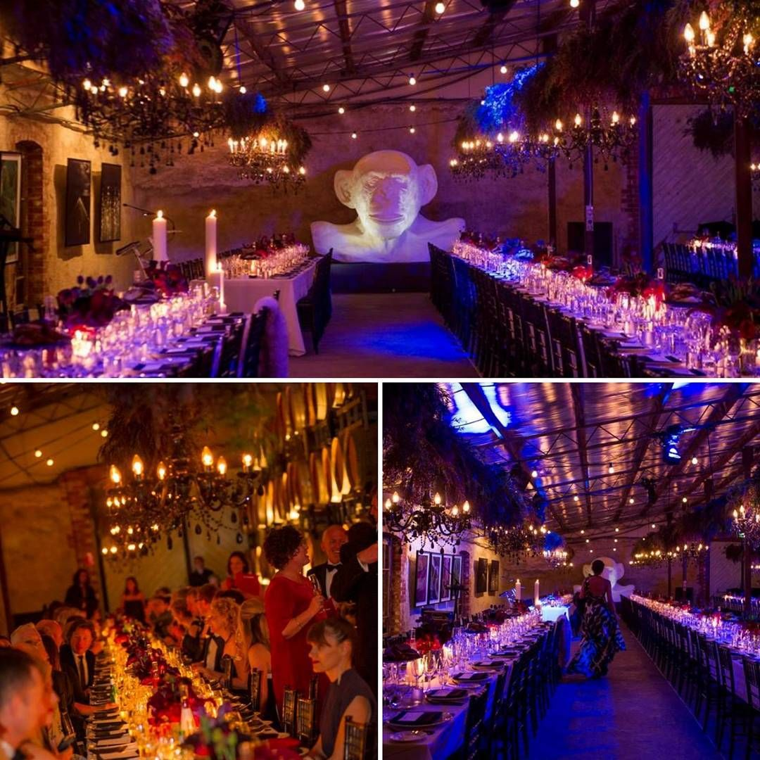 Showstopping Black Chandeliers And Suspended Greenery At