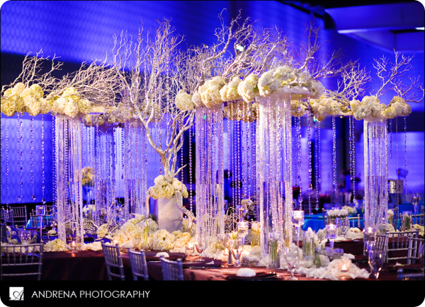 raised platforms over cascading crystal support rows of flowers – Chandelier Wedding Centerpieces
