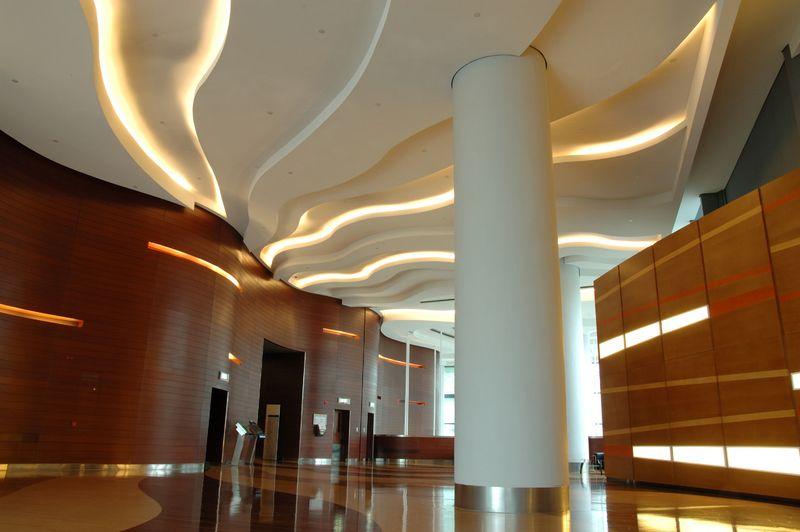 Lighting In Curved GWB Ceiling And Veneer Wall Panels