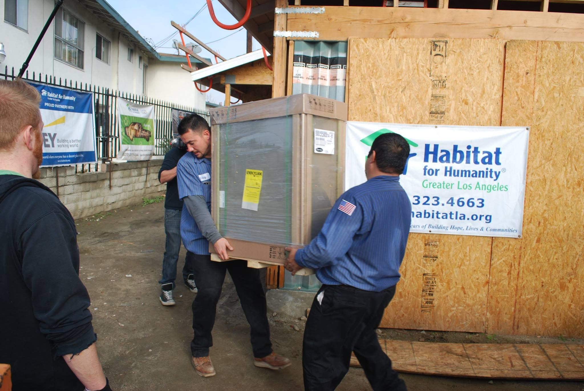 Carrier donating equipment and working with Habitat of