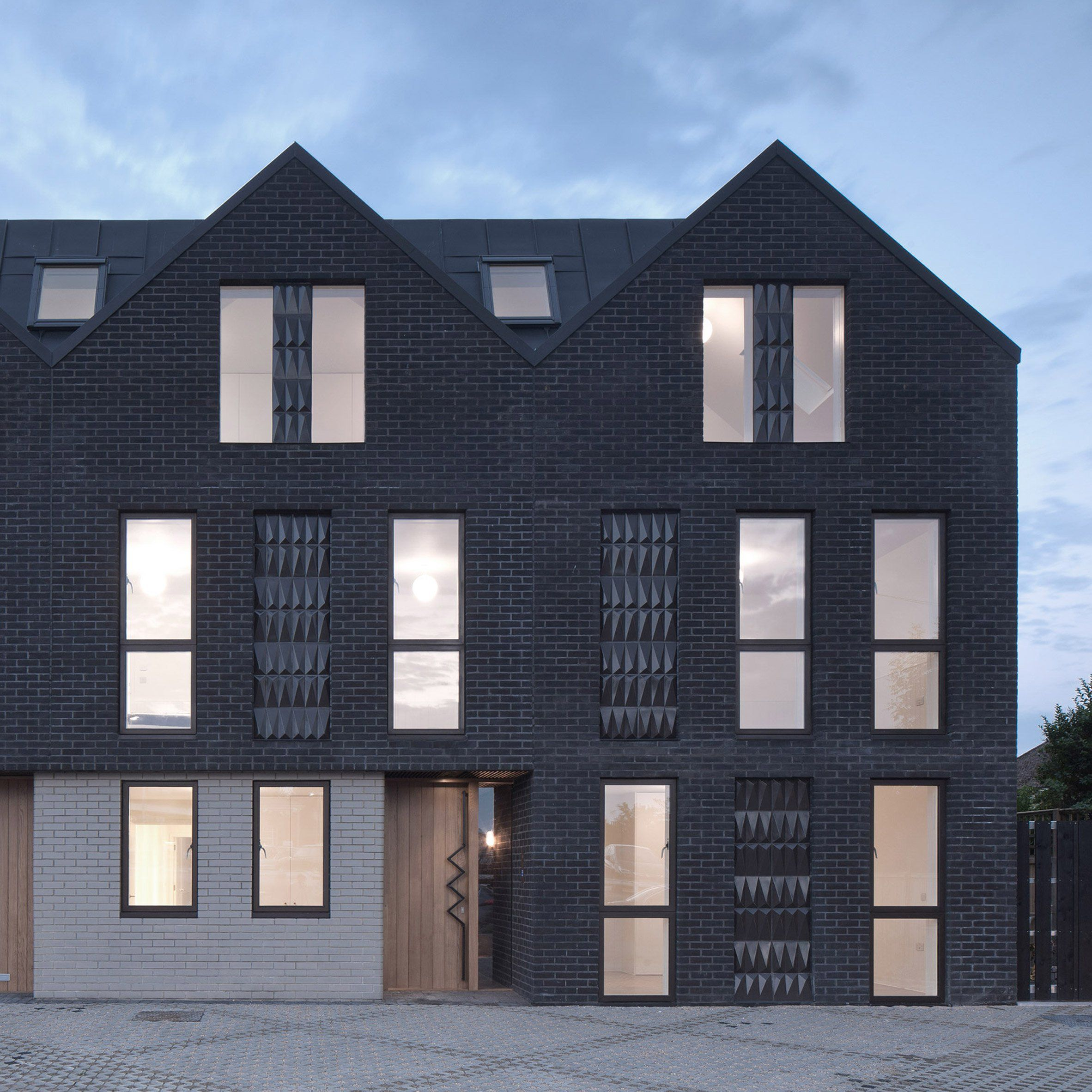 Denizen Works Pairs Black Bricks With Pointy Panels For
