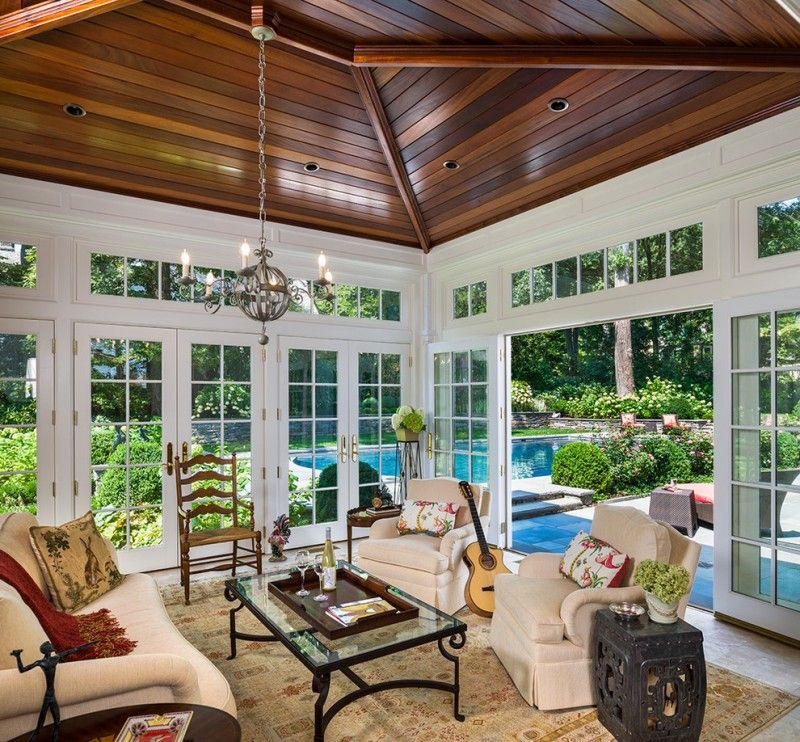 Four Season Porch Brown Wood Ceiling Traditional Sunroom Romantic Style White Couch Arabian Rug Swimming Pool Vi Four Seasons Room Sunroom Designs Florida Room