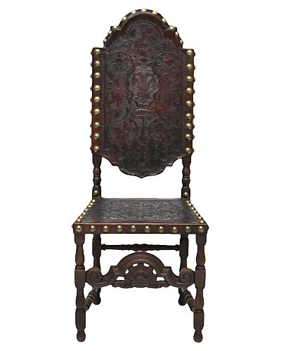 A Tooled Leather And Nailhead Trimmed Spanish Chair.