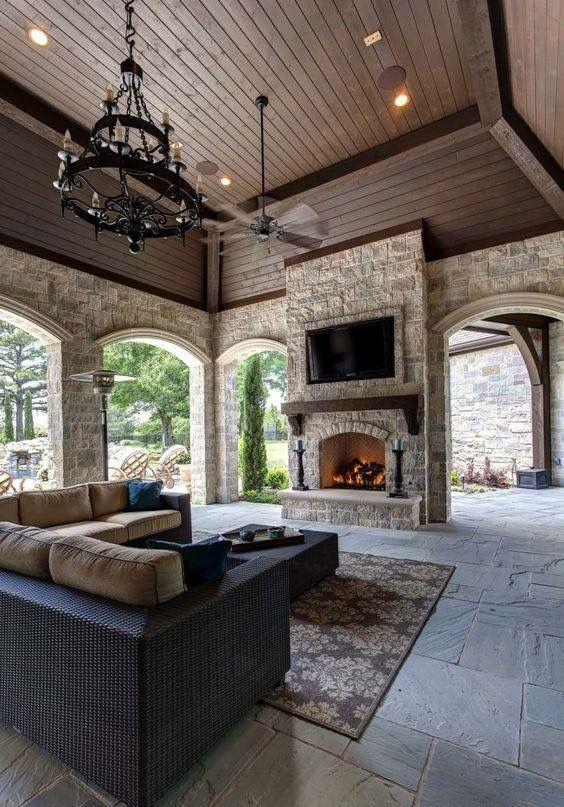 Love The Stone Arches Ceiling And Fireplace In This Covered Patio House Dream House Home