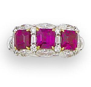 A ruby and diamond three-stone ring.