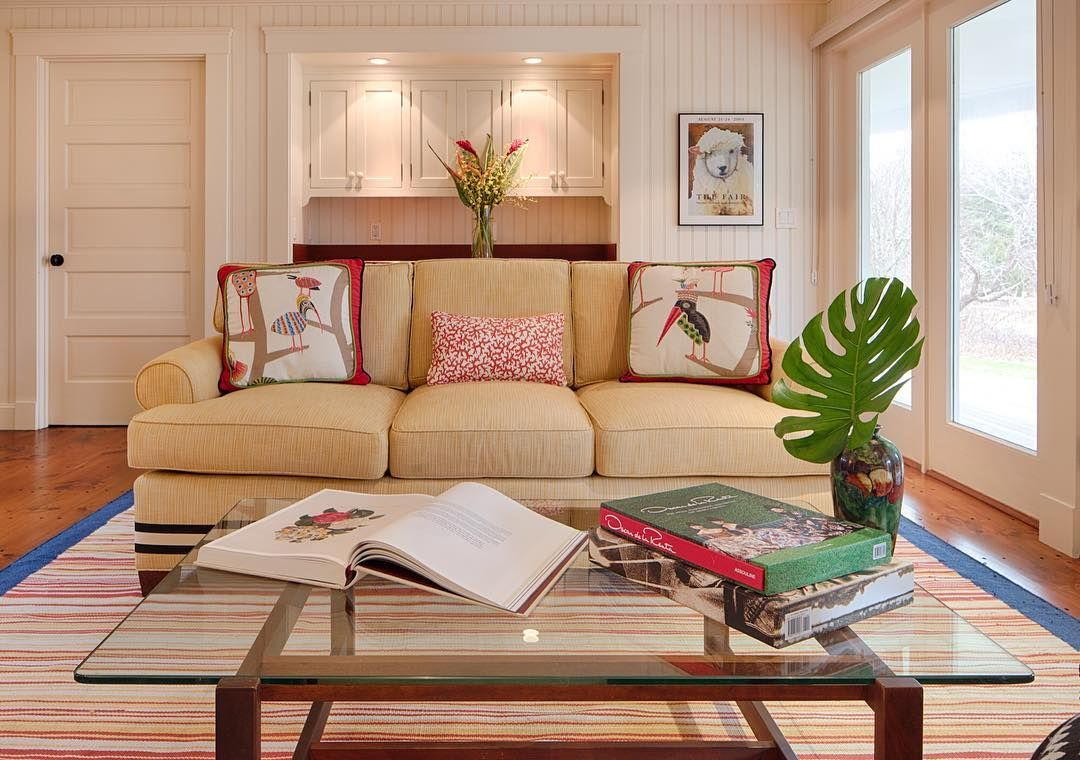 The Upholstered Light Yellow #transitional Couch In The Family Room  Welcomes A #modern Touch