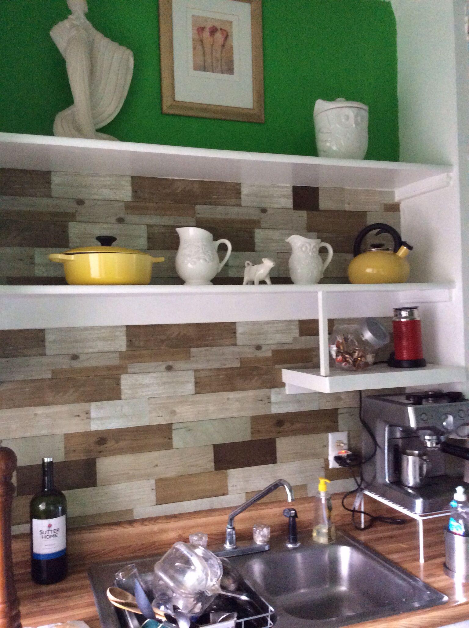Wood panel wall paper backsplash. An affordable