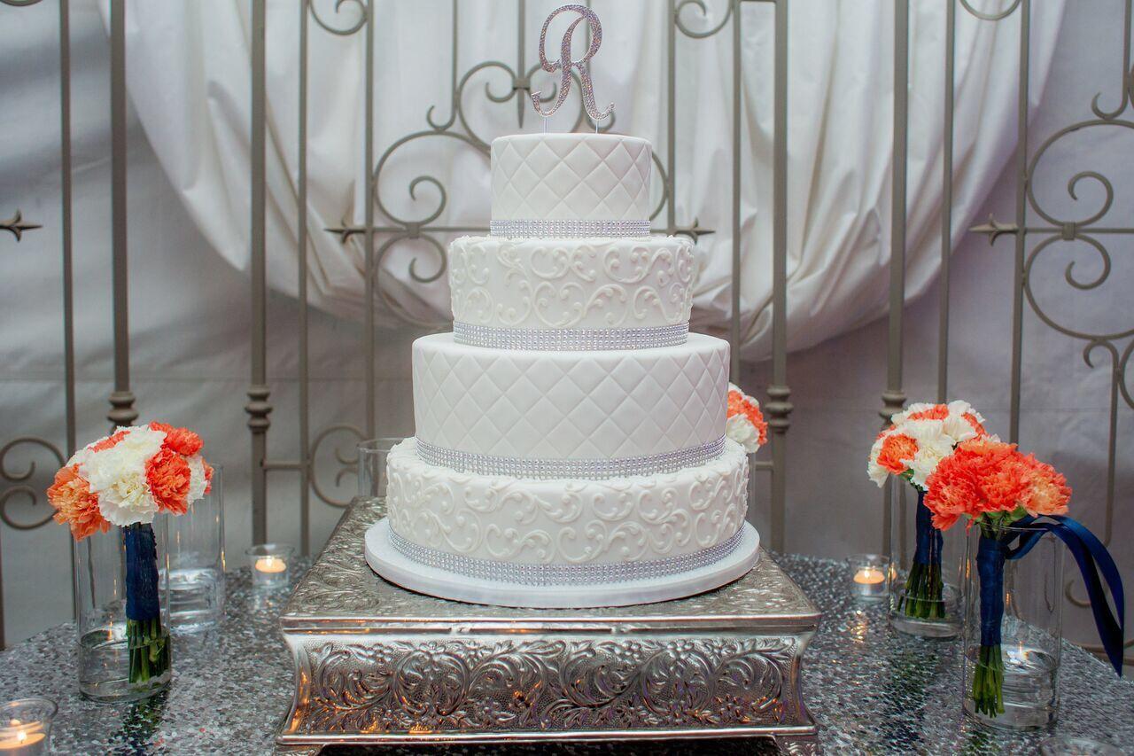 Elegant, simple white cake by Piece of Cake Bakery  Venue: Garden Pavilion @ Stonebridge Manor  Photography: Brinkerhoff Photography