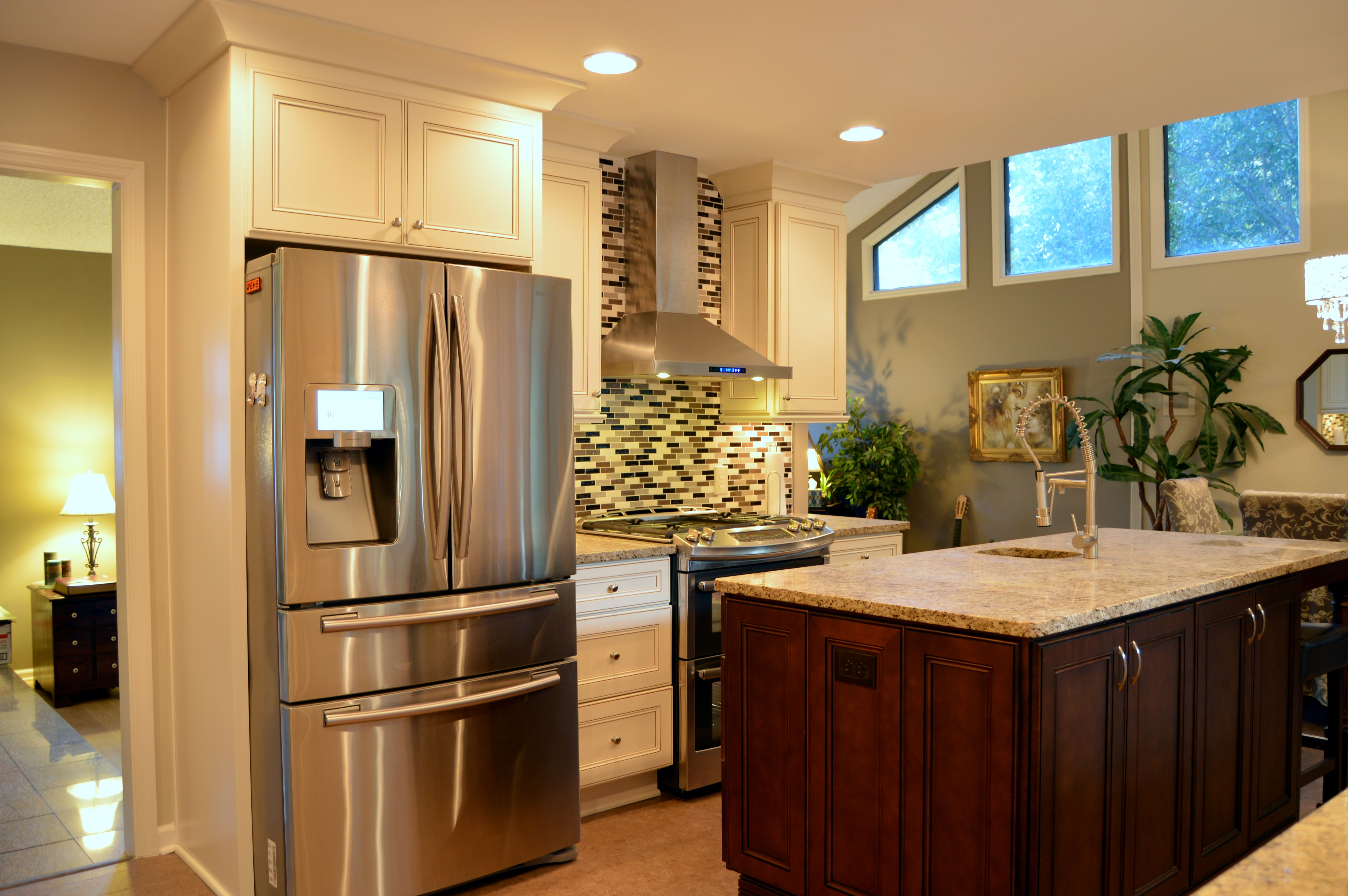 York Antique White And Chocolate Cabinets Mixed Glass Mosaic Backsplash Stainless Steel Applianc Glass Mosaic Backsplash Contemporary Kitchen Kitchen Remodel