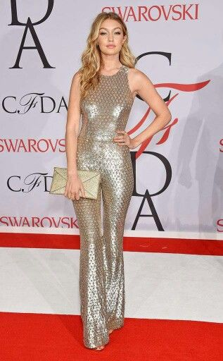 f4038cd475f1 Gigi Hadid in a gold jumpsuit from Michael Kors at the Council of Fashion  Designers of America (CFDA) Awards