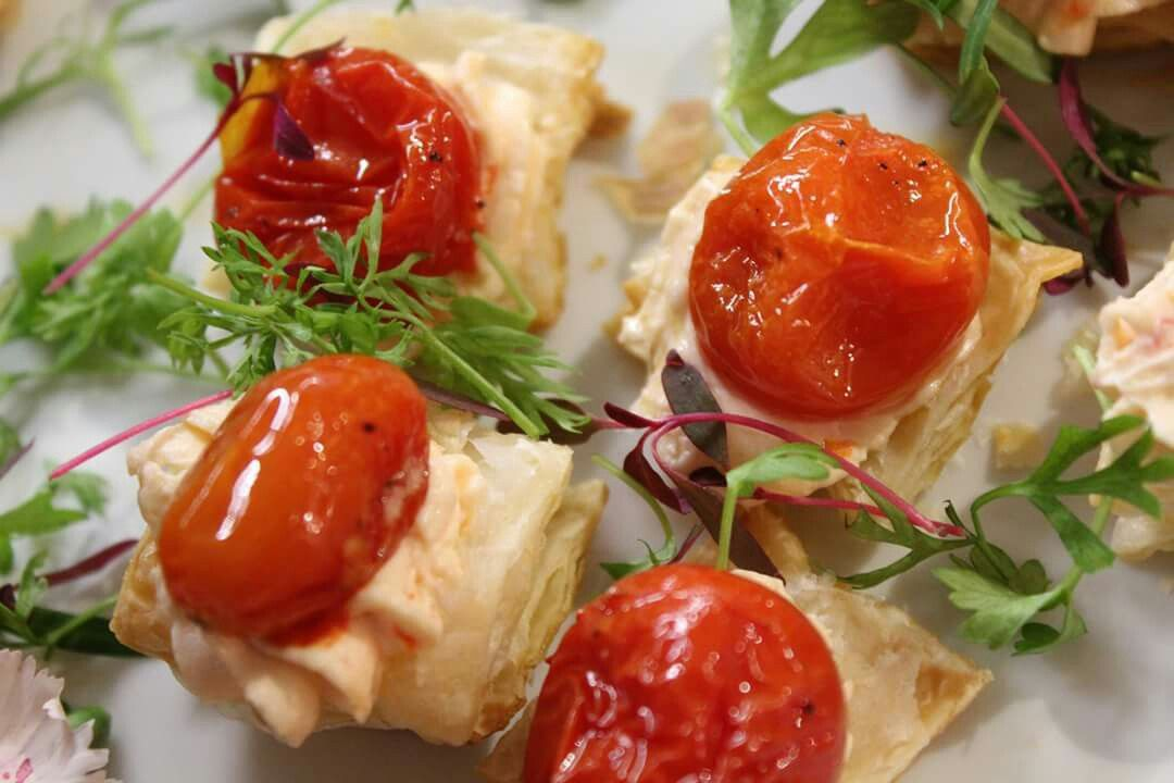 Puff pastry, sundried tomato goat cheese spread, roasted grape tomatoes