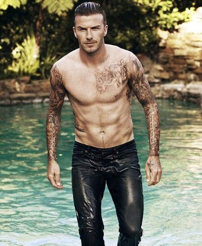 Soaking wet and emerging from a swimming pool, David Beckham graces Elle magazine's first solo male cover.