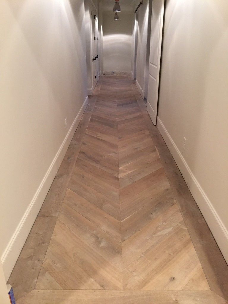 Herringbone wooden floor in a hallway for the home for Homes with hardwood floors