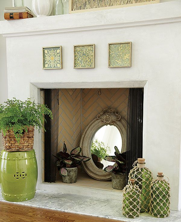 Our favorite fillers for a cool summer fireplace unused - Decorate non working fireplace ...