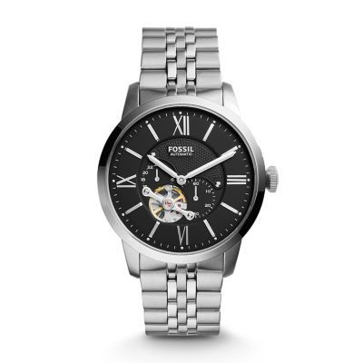 Townsman Automatic Stainless Steel Watch The top-of-the-hour Townsman automatic takes its cues from vintage designs. Included with our up-to-the-minute innovation?  A refined steel case houses a clear crystal lens and black satin dial.