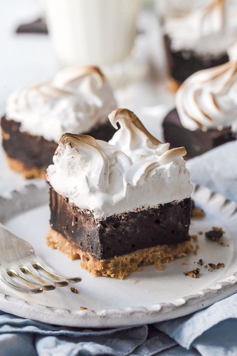Sitting on a biscuit base, these decadent S'mores brownies are then topped with light as air mars