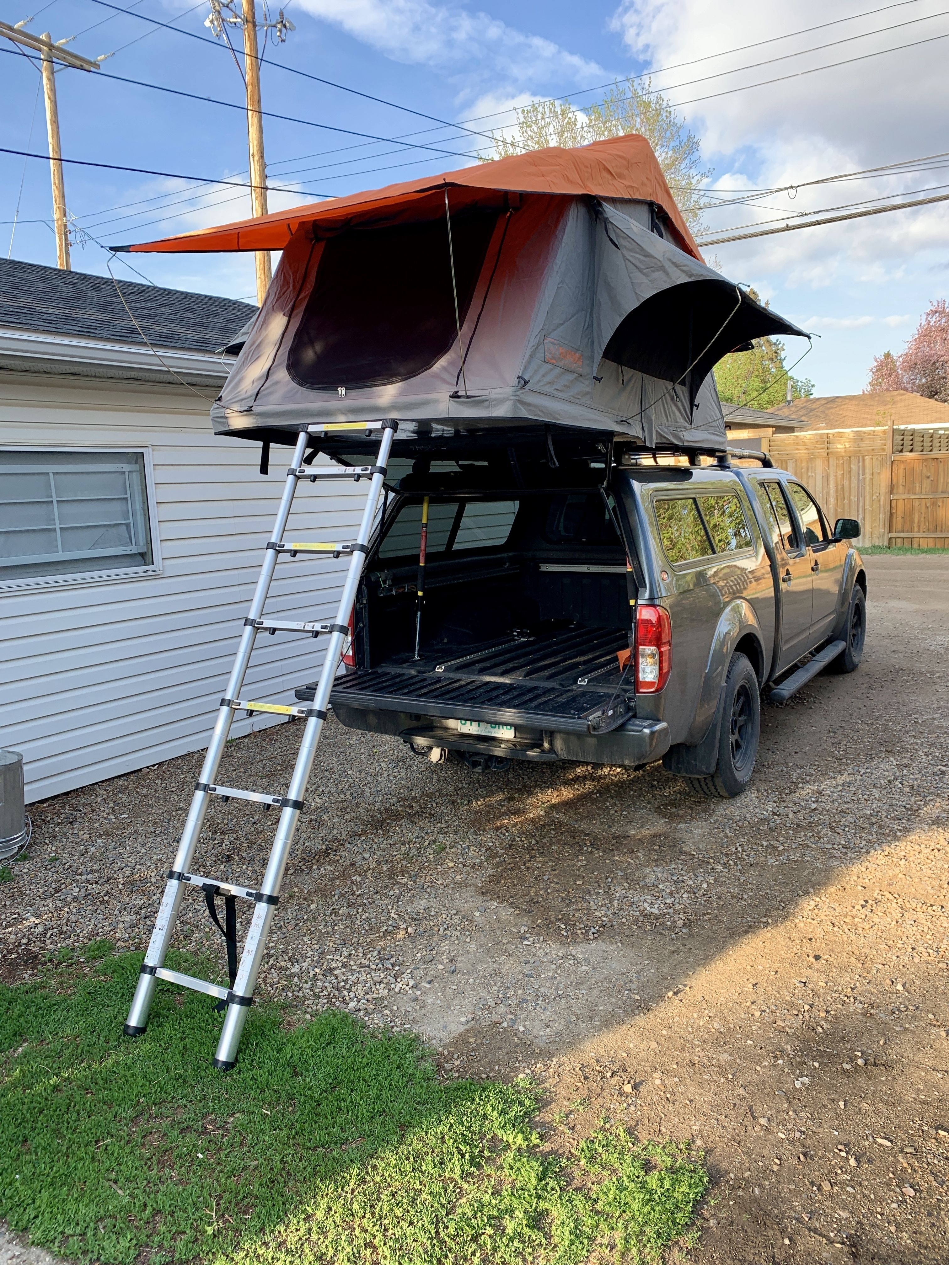 Burmis Roof Top Tent Mounted On A Thule Roof Rack On Raider Cap