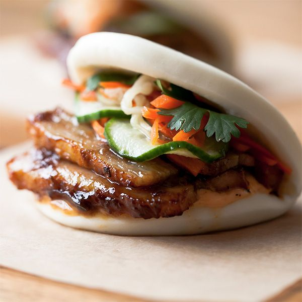 Glazed pork belly bun (with finely sliced cucumber, sprigs of fresh cilantro, slaw of pickled white radish and carrots, smear of chipotle mayonnaise.)