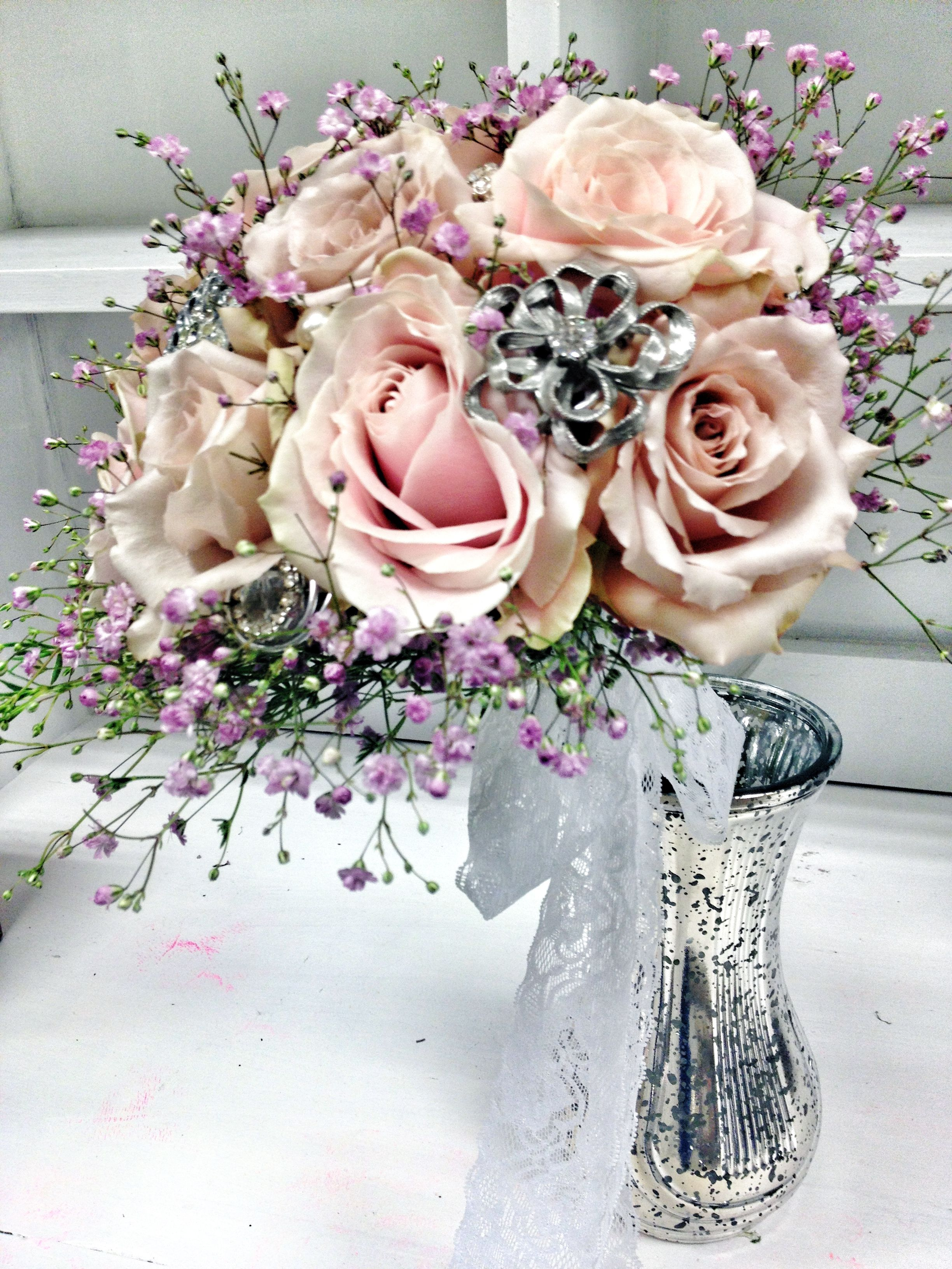 Quicksand And Sweet Avalanche Roses Surrounded By Pink Babys Breath