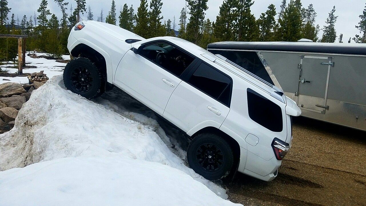 Lifted 2016 4runner climbing snow pile. Fuel wheels, Icon