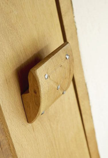 Door latch with cut rose head nails.