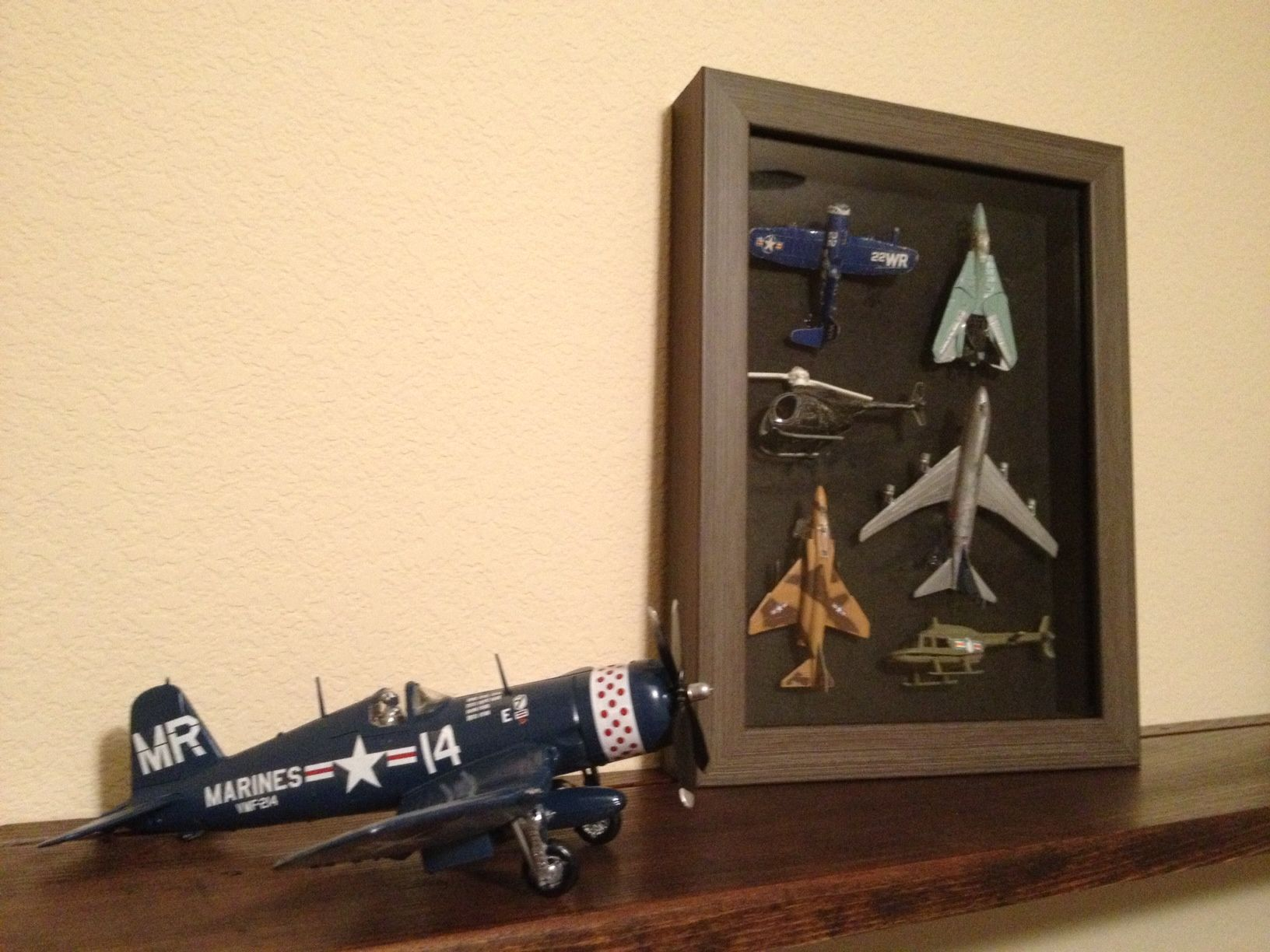 Airplane nursery. Shadowbox of Daddy\'s old toy planes and ...