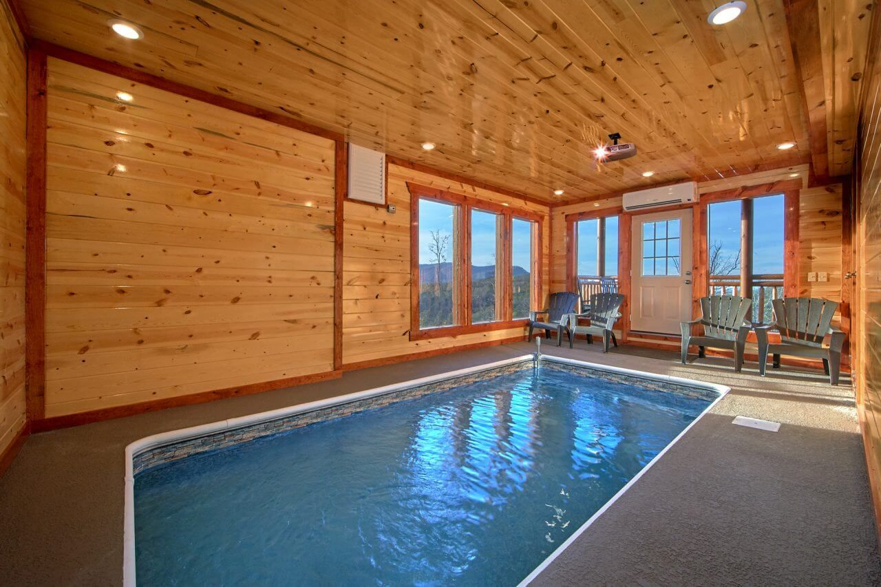 Enjoy Amazing Views And Your Own Private Indoor Pool With Theater From Top Of The World Pool Gatlinburg Cabin Rentals Gatlinburg Cabins Mountain Cabin Rentals
