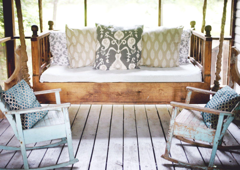 A diamondshape motif encircles the modern porch swing bed