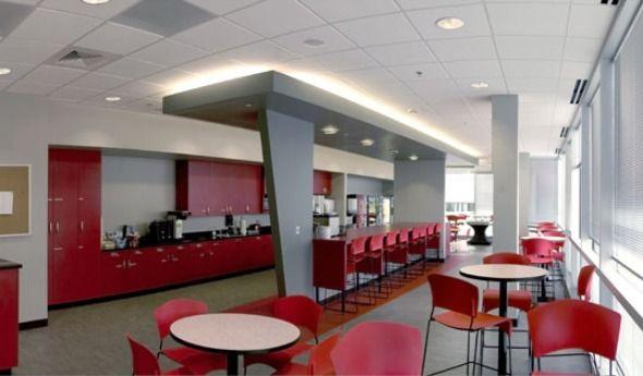 This Large Breakroom Features Plenty Of Seating And Bright Colors Break Room Design Office Break Room Break Room