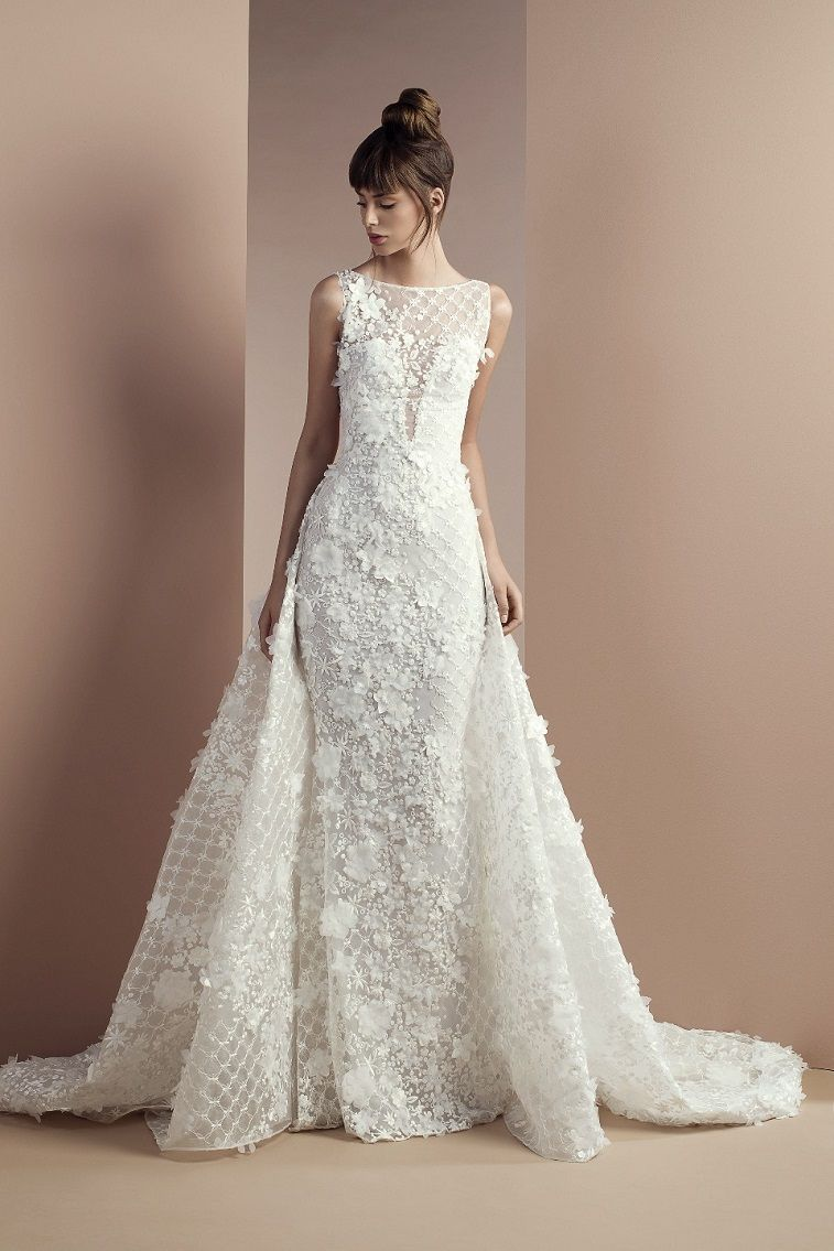 Off white lace dress with bateau neckline and an overskirt with a