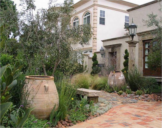 Mediterranean Garden Design Set Olive Jarslove The Way A Random Pot Looks Set In Among The .