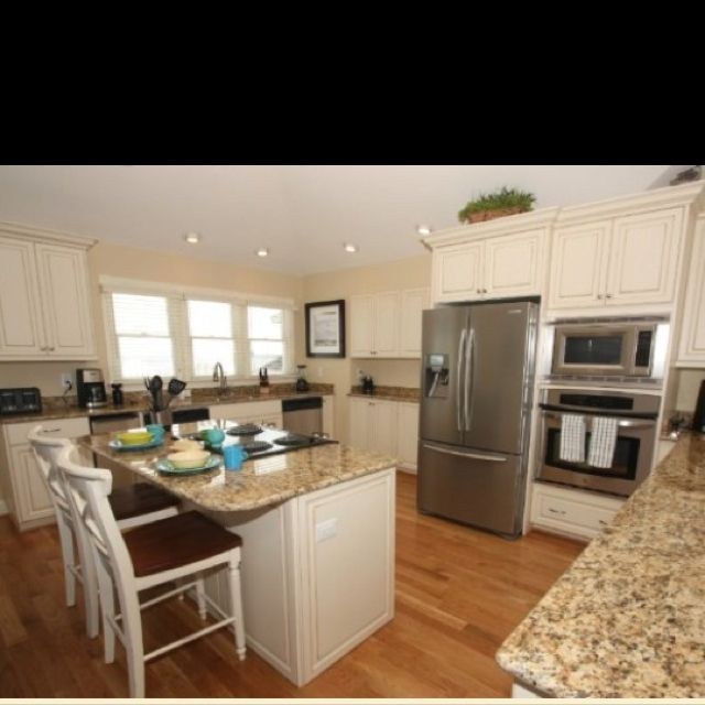 Can White Kitchen Cabinets Be Repainted