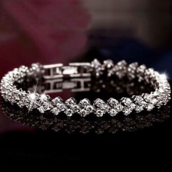 """FLASH HP Sterling Crystal Bracelet Simply stunning!! This is a true beauty!! Even prettier in person! 7"""" length! Everyone I show this bracelet to thinks it cost $150! Jewelry Bracelets"""