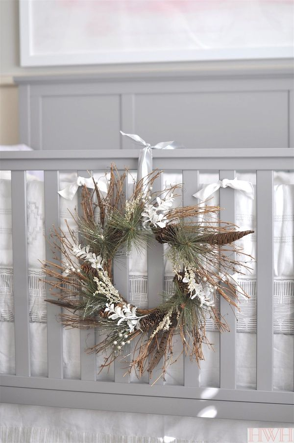 Pretty holiday wreath hung from crib in nursery.  Just lovely! | Honey We're Home
